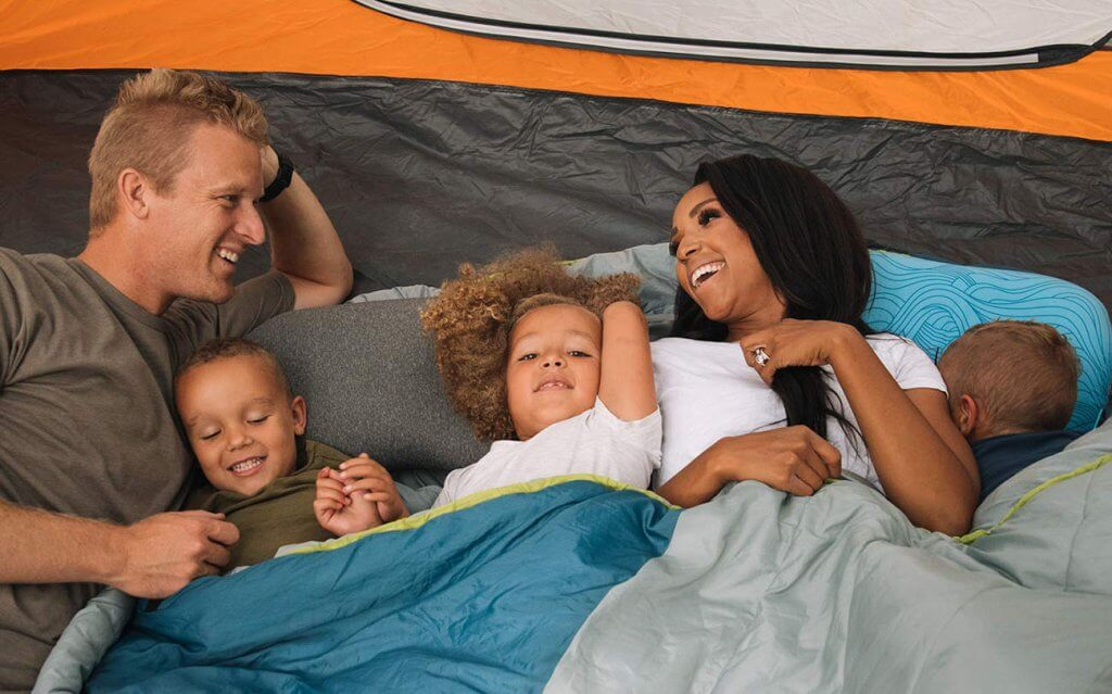 Wildhorn Sage Ultralight Inflatable Camping Pillow and a family on a camping trip