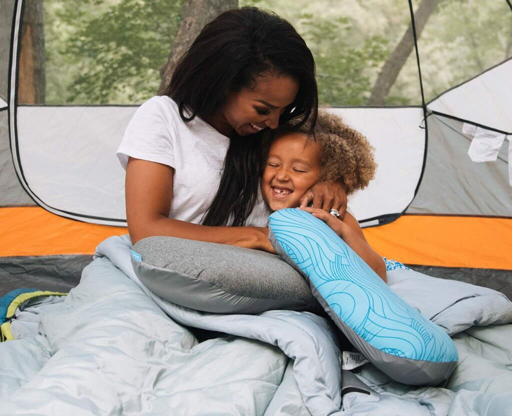 Wildhorn Sage Ultralight Inflatable Camping Pillow in a family tent