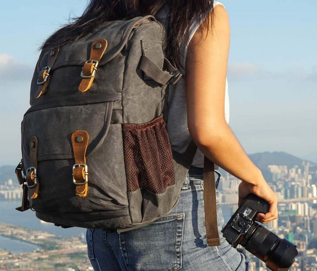 Abonnyc Vintage DSLR Backpack worn in the outdoors