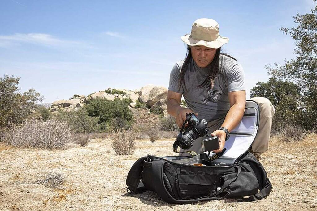photographer opening a camera backpack