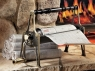 The Newspaper Log Roller lets you heat with newspaper