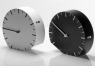 The Ora ILegale Clock adjusts for daylight savings by tipping