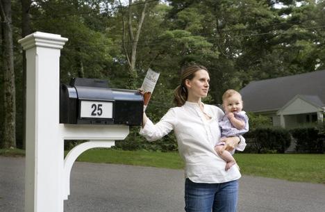 woman-using-guiding-light-mailbox
